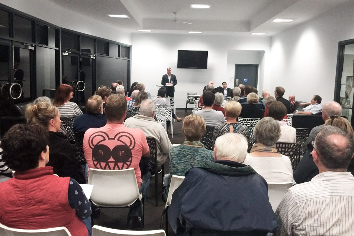 Addressing concerned residents at a local forum