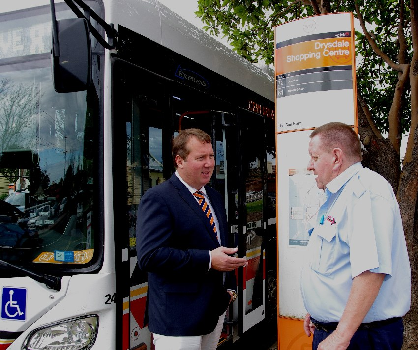 With a local bus driver, talking about public transport user problems to make the journey better